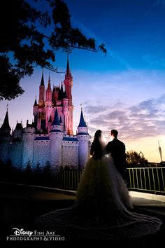 It doesn't get much more romantic than newlywed moments in the shadow of Cinderella Castle
