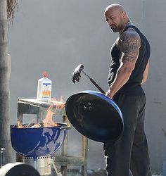 Here is a photo that is begging for a caption contest... - Pain and Gain Set Photo with Dwayne Johnson Cooking a Severed Hand - Michael Bay directs this true crime drama about a pair of bodybuilders who get involved in a kidnapping and extortion scheme.