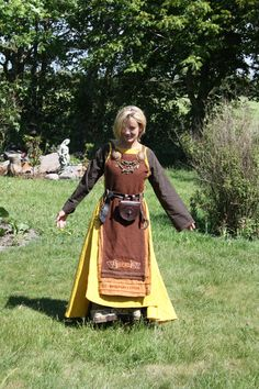 Please read this about belts: http://www.medieval-baltic.us/vikbuckle.html Please read this about apron dress construction and decoration: http://urd.priv.no/viking/smokkr.html