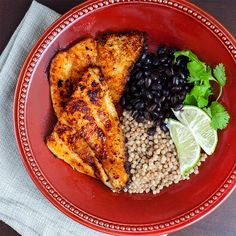 simple blackened tilapia over spicy black beans and puffed millet, with lime & fresh cilantro ~ mmmm my kind of meal
