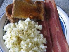 Meal 1: 3 Egg Whites (90 cal), 3 slices extra lean turkey bacon (60 cal), 1 slice of whole wheat bread w/o jam (50-70 cal) Love this for breakfast. I sometimes have 1 hardboiled egg as well and a few tsps of Franks Red Hot on my egg whites to add a little kick to it :)