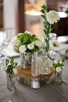 Rustic centerpieces - minus the slab of wood, add some blush pink and brassy gold. hello russo reception :)
