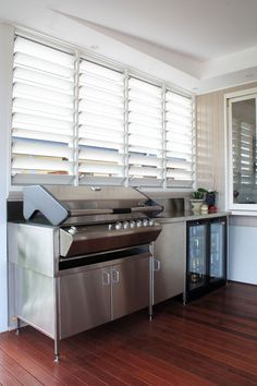 love the luver windows. stain on deck is fantastic color. weatherboard with white roof?