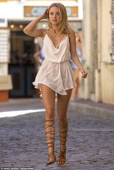 Grecian chic: The thigh-skimming playsuit was formed of flowing white material, draping across her slender frame