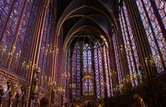 Famous stained glass windows and ceiling within La Sainte-Chapelle Chapel in Paris, France  (Been there; it's STUNNING!)