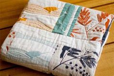 Ink and Spindle will send you all the material you need to sew up a quilt for your little one: eight of their prints, and a plain border fab...