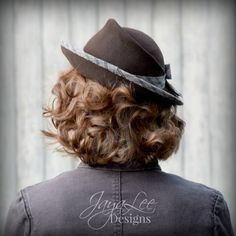 Tilt Hat in Rustic Brown and Green by Jaya Lee  This stunning 1930s style tilt hat was hand blocked on a refurbished antique millinery hat block from the 1930s. The hat is made from a brown millinery fur felt and is trimmed with vintage cotton plaid fabric (Plaid print is: tan, brown, and navy blue) . The hat is a classic 1930s tilt hat shape. The crown is shallow, with a ridge on the left side. The hat is designed to sit on high on the head and tilt down to the right. The brim snaps up in…