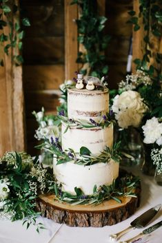 Old-Fashioned Country Wedding Ideas Trim a semi-naked cake with greenery and wildflowers and serve it on a tree stump for a woodsy touch.Trim a semi-naked cake with greenery and wildflowers and serve it on a tree stump for a woodsy touch. Bolos Naked Cake, Caterpillar Cake, Wedding Cake Rustic, Vegan Wedding Cakes, Seminaked Wedding Cake, Wedding Cake With Topper, Wedding Reception, Whimsical Wedding Cakes, Rustic Cake
