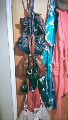Hang bags vertically on the back of your door so you can see all of your options while keeping thing neat. To prevent wear and tear ensure all bags are empty and put heavier, more durable purses at the top.