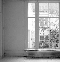 Empty rooms with big windows