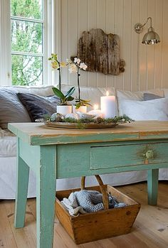 Beachy weathered table. I love the look of this whole living room!!