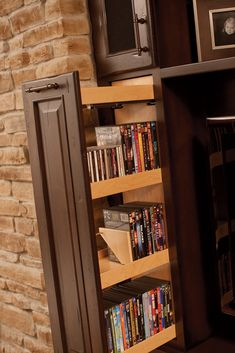Vertical Dura Supreme Cabinetry pull-outs for your entertainment center organizes CDs and DVDs in your media library.