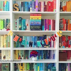 It feels like a #shelfiesaturday to me. At least a partial shelfie. 🌈 My bookcases are full and overflowing. I need to do another purge soon. I purge books I've read and didn't love and books I purchased a long time ago, but still haven't read and realistically probably won't ever read. It makes me sad, but it has to be done.