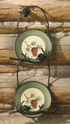 Crafted to replicate pine boughs and pinecones the lodge styled plate racks will beautifully display your favorite plates, $22.00
