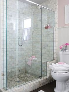 The Glass Enclosure Stair Steps Up A Marble Frame, Highlighting The Shower  Bench And