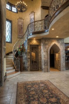 Mediterranean Entryway with Exposed beam, Hanging tapestry, Chandelier, can lights, Cathedral ceiling, Wine cellar door