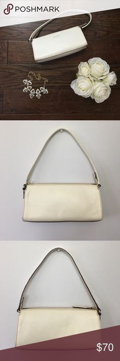 "Kate Spade Shoulder Bag Kate Spade off white shoulder bag. Good condition but has a few marks as shown in the last 2 pictures. Most are very minor. Dimensions: 10.5"" width, 5"" tall, side bottom 3"" and side top 2"", 21.5"" strap. Comes with dust bag. kate spade Bags Shoulder Bags"