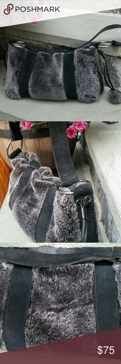 Stuart Weitzman Furry Purse With Snap Close This faux fur shoulder bag features one fuzzy pom on each side. Top snaps closed. Excellent used condition. Stuart Weitzman Bags Shoulder Bags