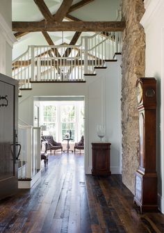 An American farmhouse.  Rustic refinement. White and dark stained wood. Donald Lococo Architects, McLean, VA