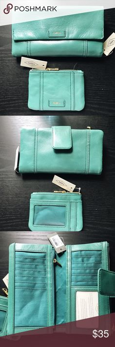 Fossil Wallet w/ Fossil Coin Purse Super cute Wallet and coin bag. Both are brand new with tags. Stunning blue color! Wallet retail for $75 and coin for $40 so this is such a great deal! Fossil Bags Wallets
