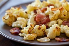 Roasted Cauliflower with Bacon & Garlic  Made 2 batches for Christmas dinner and it was devoured!  12-25-11    1-22-12  Made again with 1 head + 8 strips of bacon + 2 TBSP evoo + 8 cloves of garlic and salt and pepper....  OMG!  This is TO DIE FOR!  @Ann Flanigan Flanigan Hinds  (you need to try this too)