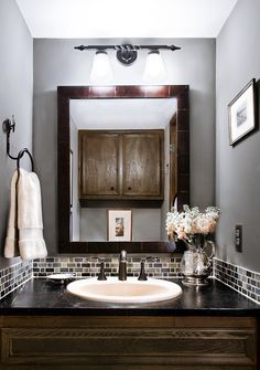 Really like the tile accent around the vanity - for the powder room