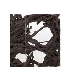 """""""'Revival,' by the French designer Jerome Abel Seguin, contains nine sculptural pieces made of slices of enormous mahogany trees that were felled in central Java early in the 20th century. The pieces, some of which even contain large stones that became embedded in the trees, are at once graphic and textural, primal, and extremely powerful."""""""
