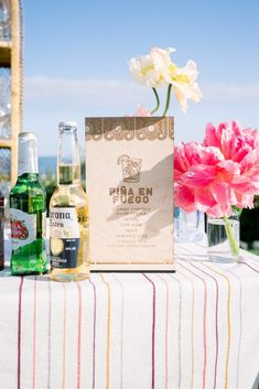 Sabrina & Yishai's outdoor Welcome Party featured bold and vibrant colors for a beach side dinner party. Guests enjoyed signature drinks and relaxed views of the ocean waves. We created a an elegant fiesta theme party with  simple decor combined with natural casual elements creating a fun start to the wedding events.  | Bob Gail Events #beachside #welcomeparty #fiestatheme Fiesta Theme Party, Party Themes, Tequila, Mezcal Cocktails, Hawaiian Party Decorations, Mixed Drinks Alcohol, Welcome To The Party, Signature Cocktail, Outdoor Parties