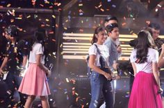 This is James Reid, Nadine Lustre, Kathryn Bernardo, and Daniel Padilla with the hosts of Showtime smiling for the camera while leaving the stage after the end/big wrap of It's Showtime Kapamilya Day last September 26, 2015 at the Smart Araneta Coliseum. JaDine and KathNiel are dressed casually with white #KiligKapamilya shirts. They're very pretty and handsome, indeed. :-)