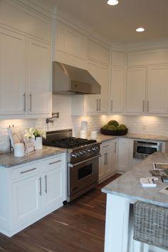 brick backsplash, white kitchen