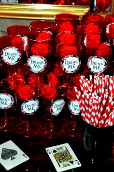 "Really cute Alice in Wonderland drink idea. Red ""Queen of Hearts"" glasses that say ""Drink me"". Perfect for a Disney Villains Halloween party."