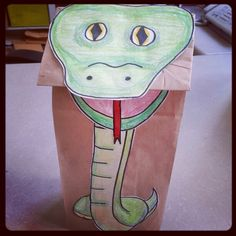 Ssss...slithers in the snake. Come and check out our reptile storytime and make a fun & easy snake paperbag craft here @ Alamitos library!