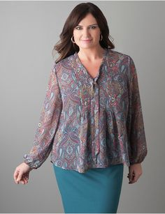Plus Size Pintuck Paisley Blouse. Beautiful blouse flaunts your feminine charm with pintuck pleats, tie neck and a brightly-colored paisley print. Finished with long bracelet sleeves and covered buttons on partial placket. Sheer, textured chiffon layers beautifully for casual and dressy looks.