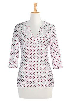 Our cotton knit top with glittery heart print is fashioned with a deep split neckline tip trimmed for retro styling.