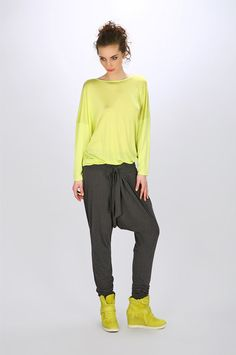 We can't decide if this pant trend is a fashion do or don't: https://www.cityblis.com/5433/item/11377 | Lime blouse - $67 by SheMore | Interesting blouse with long sleeves. Delicate neckline.At the top  viscose silk, nice and chilled for the body.Ended by elastic, making it very nicely arranged. | #Tops/Blouses
