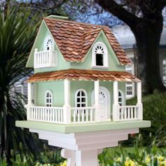 "•Hobbitt decorative bird house   •Curved western red pine shingles top this house    •A cute little porch and side balconies    •Back wall can be removed for convenient cleaning   •Coat with a UV protected polyurethane to keep your house looking new year after year   •Opening: 1""W x 1.25""H     Dimensions:12.5""D x 7.5""W x 14.5""H"