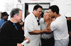 """On the set of """"Ali"""", 2001.  L to R: Writer/producer/director Michael Mann, Muhammad Ali, Angelo Dundee, Will Smith."""
