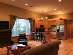 Open floor plan with living room & kitchen.  Beautiful forest views w/ waterfall