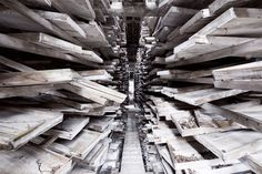 Post Fukushima Japan: a view inside an abandoned chalk mine. These wooden structures were once the drying sheds where chalk was dried to air currents. - Photo by Reginald Van de Velde