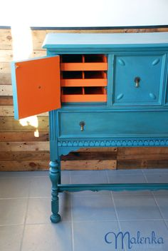 Barcelona Orange and a custom blue mix of Chalk Paint® decorative paint by Annie Sloan make this a standout. Artistry by Malenka Originals.