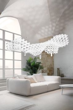 """""""We didn't make a lamp, we made a ceiling"""". Miguel Arruda introduces Nuvem with these words. It is a ceiling, illuminated by bidirectional spotlights Floating In Space, Make A Lamp, Light Art, Small Tables, Lamp, Architectural Elements, Pendant Lamp, Lighting System, Slamp"""