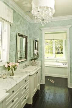 Dark wood floors - separate room for bathtub - contrasting walls.