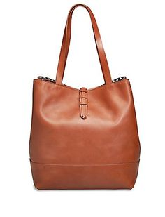 f994b13097ea Essential tote bag crafted from supple leather. Features a top handle and  multiple interior pockets. 18 inches long x inches high x wide