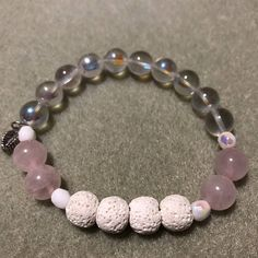Rose Quartz Diffuser Bracelet white lava essential oils diffuser beads, rose quartz gemstone beads, clear glass beads, white accent beads, and a leaf charm.