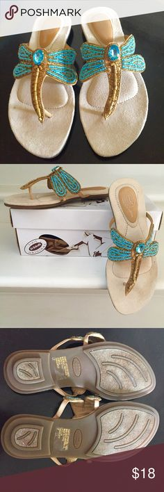 Dragonfly Sandals, size 7M Beaded Dragonfly Sandals by Dr. Scholl's, size 7M, Dragonfly Turquoise, 416DS64 style. Fly through summer with these unique leather sandals. Dragonfly was created with stitchings of turquoise and gold glass beads with longer wooden beads and a large center turquoise rhinestone bead. Rubber non-skid soles and heels. Heels are fashioned as three stacked layers in decreasing size. Excellent condition with original box and packing tissues. Dr. Scholl's Shoes Sandals
