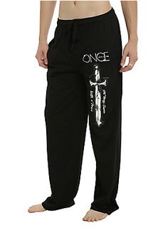 "Comfy guys pajama pants from <i>Once Upon A Time</i> with a Rumpelstiltskin quote design on the left leg that reads ""All Magic Comes With A Price."" Elastic drawstring waist with hip pockets and single button fly.<br><ul><li style=""list-style-position: inside !important; list-style-type: disc !important"">60% cotton; 40% polyester</li><li style=""list-style-position: inside !important; list-style-type: disc !important"">Wash cold; dry low</li><li style=""list-style-position: inside !important…"
