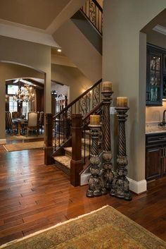 I'd take away the candle sticks, and change the dining area furniture to all one color -Alexis