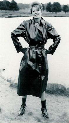 One of my all-time favourite rainwear photos. Not really sure if it is a PVC or Rubber mac but there is something special about the lady in this photo.