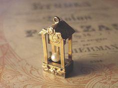 Grandfather clock charm, moveable pearl pendulum