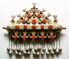 """One would not guess from a photo how large this Turkoman amulet called a """"tumar"""" and made of silver gilt and carnelians actually is, as it is constructed like smaller ones. The typical shape of the genre is as found here, with the most important part perhaps being the """"tube"""" that runs across, as that contained the verse(s) from the Koran intended to protect the wearer."""